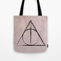 deathly hallows Tote Bags featuring Deathly Hallows (Harry Potter) by Daizy Jain