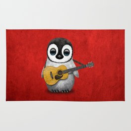 Musical Baby Penguin Playing Acoustic Guitar on Deep Red Rug