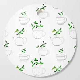 Tea plants in tea cups Cutting Board