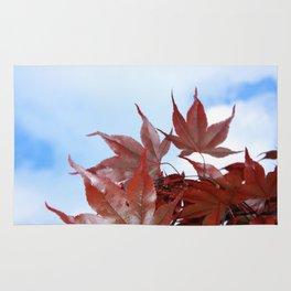 red leaf sky Rug