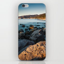 Photograph of a rocky coastline and beach iPhone Skin