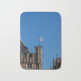 Bruges tower and flag Bath Mat