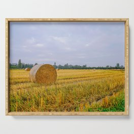 Hay bales in the Lomellina countryside during autumn Serving Tray