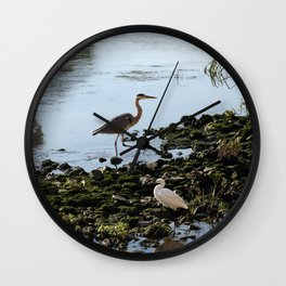 Herons on the river bank Wall Clock