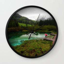 Red umbrella green lake Wall Clock