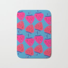 Design strawberries pink on blue Bath Mat
