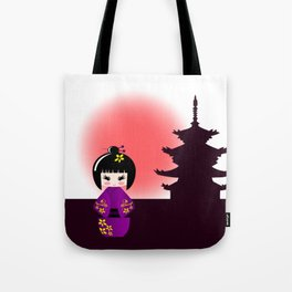 Japanese kokeshi doll at temple during sunset Tote Bag