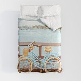 Two retro bicycles standing on Santa Barbara pier, California, USA. Vintage filter with muted teal blue and orange colors. Comforters