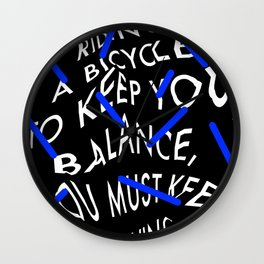 Life is like riding a bicycle. To keep your balance, you must keep moving. Albert Einstein Wall Clock