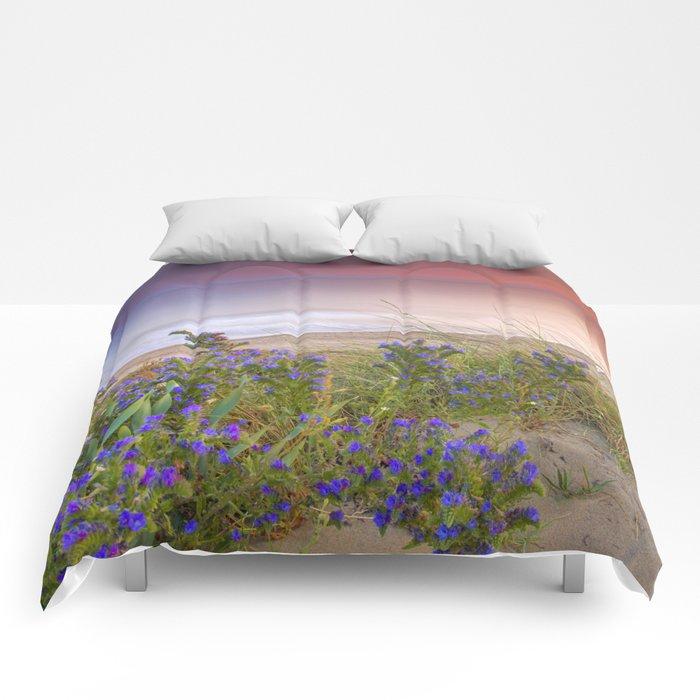 """Purple flowers at the sea sunset"" Comforters"