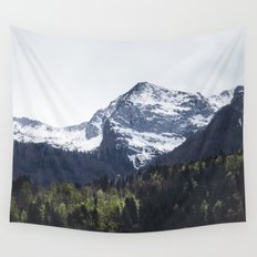 Winter and Spring - green trees and snowy mountains Wall Tapestry