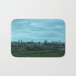 Cloudy day in the City Bath Mat