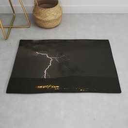 Lighting bolt during an obscure night Rug