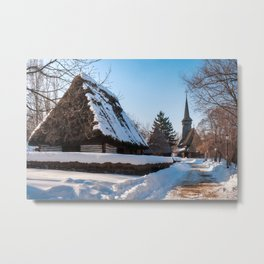 Picturesque street covered in snow at the Village Museum in Bucharest Metal Print