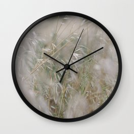 Tall wild grass growing in a meadow Wall Clock