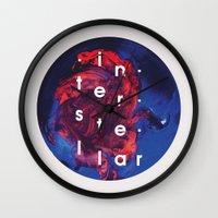 interstellar Wall Clocks featuring Interstellar by Sophie Cseve