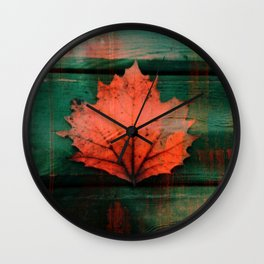 Rusty red dried fall leaf on wooden hunter green beams Wall Clock