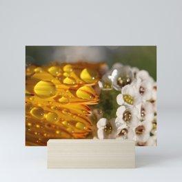 Raindrops on embracing flowers Mini Art Print