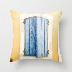 Blue wooden shutter in yellow wall. Throw Pillow