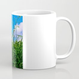 Buddha Looks Through Grass Coffee Mug