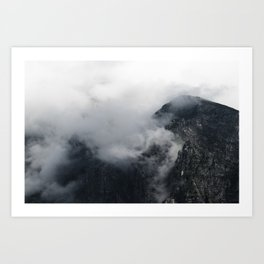 White clouds over the dark rocky mountains Art Print