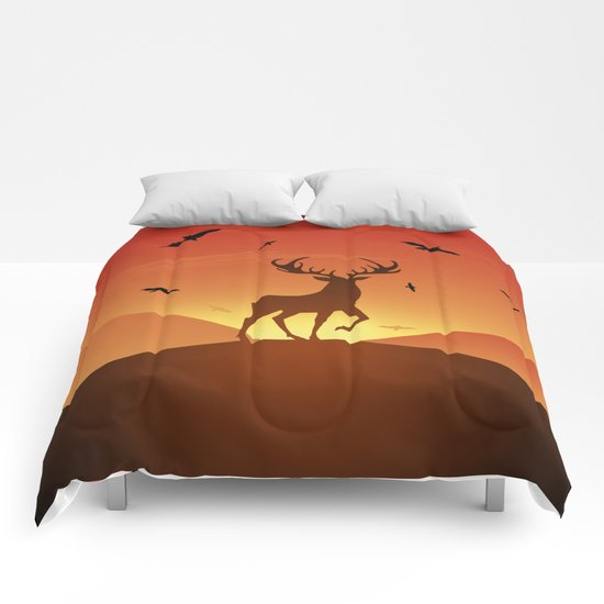 Deer at sunset Comforters