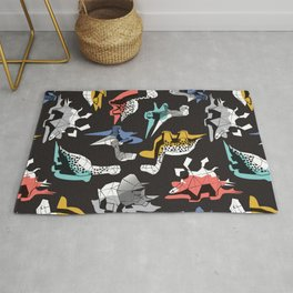 Geometric Dinos // non directional design black background multicoloured dinosaurs shadows Rug