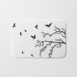 flock of flying birds on tree branch Bath Mat