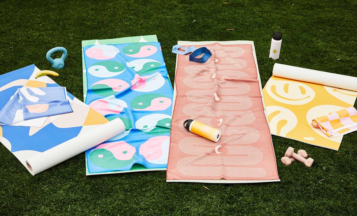 backyard setup with yoga mats and yoga towels