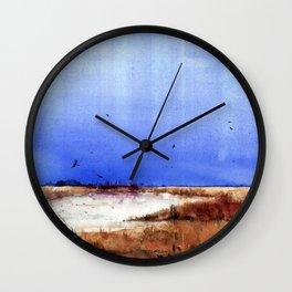 Vertical stripes over grassy landscape Wall Clock
