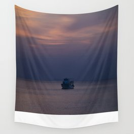 Boat at sunset Wall Tapestry