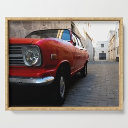 Red Car on Cobblestone Street Serving Tray