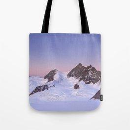 Dawn at the Jungfrau peak from Jungfraujoch in Switzerland Tote Bag