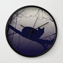 Mistery cat perching on tree in misty night Wall Clock