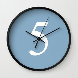 number five sign on placid blue color background Wall Clock