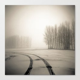 Tyre tracks in snow Canvas Print