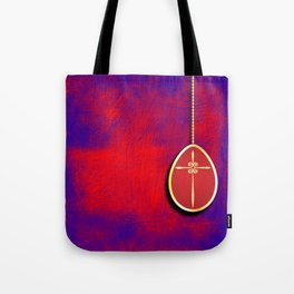 Gold cross in red egg hanging against a rich red and purple Tote Bag