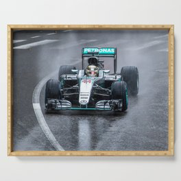 Lewis Hamilton 2016 driving his Formula 1 car in the rain Serving Tray