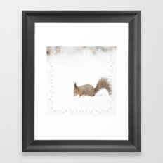Little squirrel sitting in the snow Framed Art Print