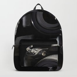 Plaster head and professional photo camera Backpack