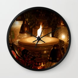 Candles Burning At a Cemetery Wall Clock