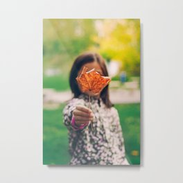 Girl holding a dry leaf Metal Print