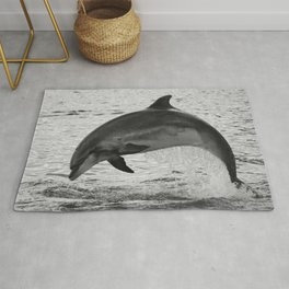 Jumping wild bottlenose dolphin black and white Rug