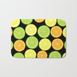 Citrus Slices on Black Bath Mat