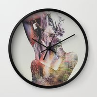 andreas preis Wall Clocks featuring Wilderness Heart by Andreas Lie