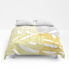 Yellow tropical leaves Comforters