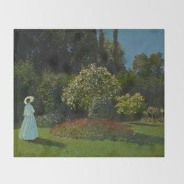 Lady in the garden Throw Blanket