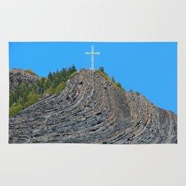 Bent rock Mountain cross Rug