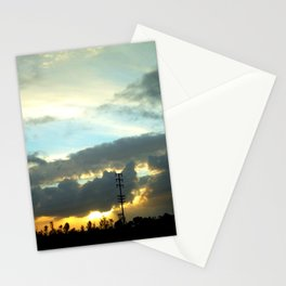 The sun peeking through the clouds. Stationery Cards