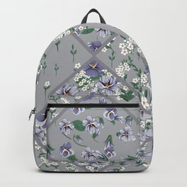 drawing of seamless patchwork pattern with viola flowers Backpack